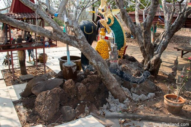 pile of stones with ruesi, naga, and cobra