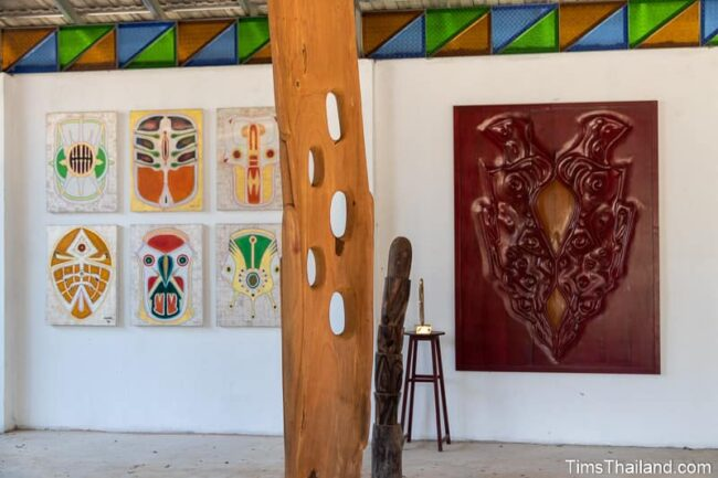 paintings and woodcarvings in a gallery
