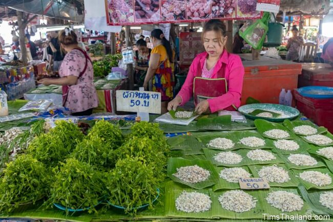 vendor with red ant eggs in market