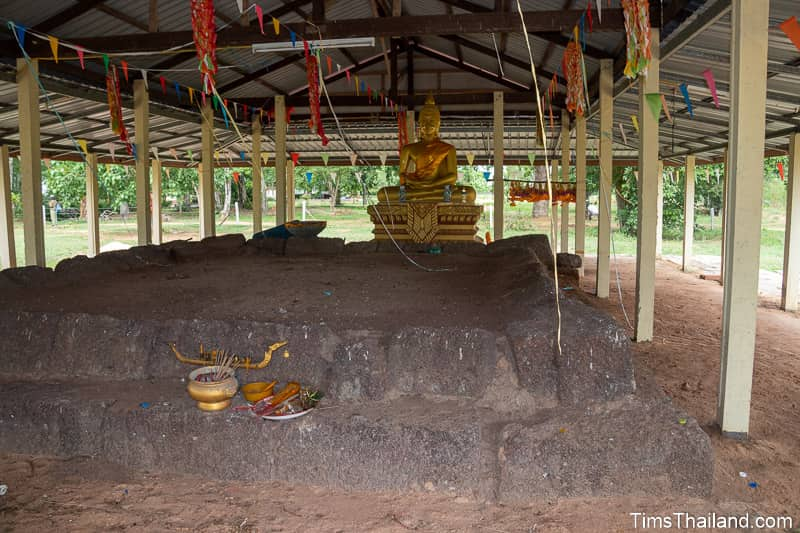 front view of Khmer ruin with Buddha in back