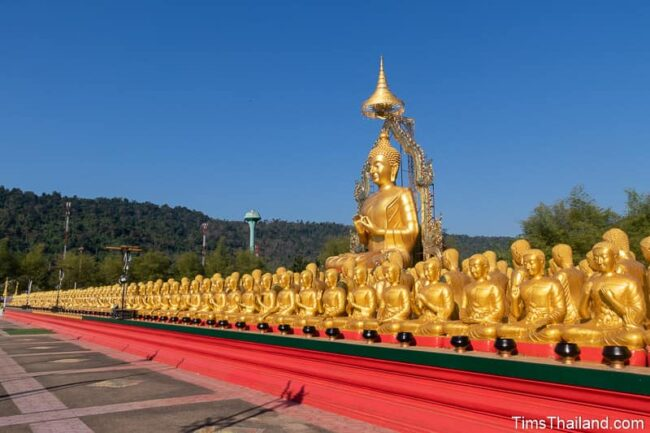 large Buddha statue surrounded by smaller monk statues