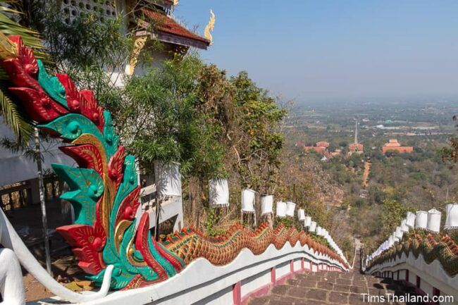 staircase lined by a long naga leading down mountain