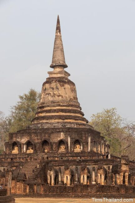 ancient stupa surrounded by elephant statues