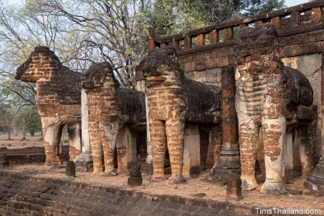 elephant statues at base of ancient stupa