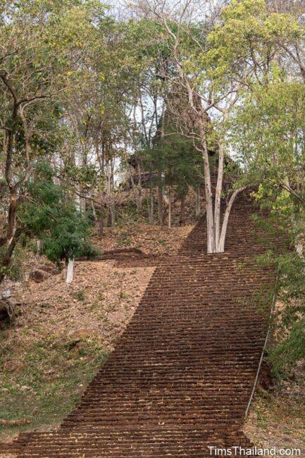 steep steps leading up to ancient stupa