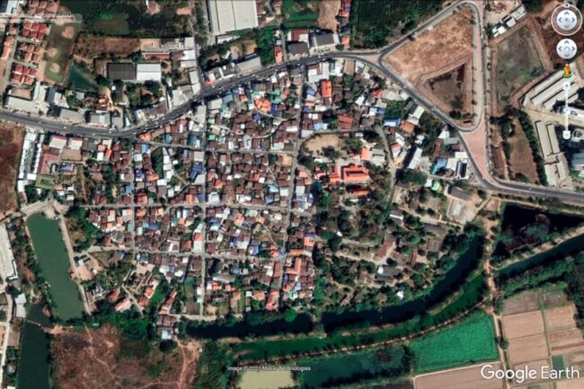 aerial view of town and moat from 2021