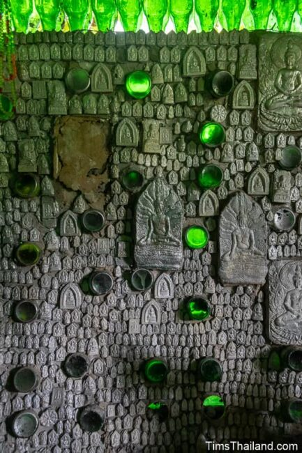 amulets and bottles on interior wall