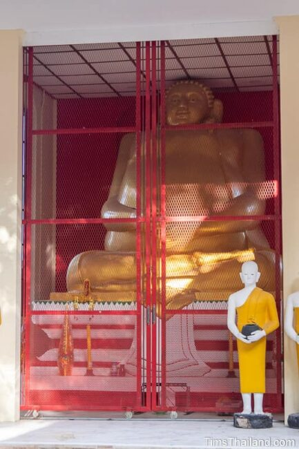 large Phra Sangkhajai shrine with clsed gate