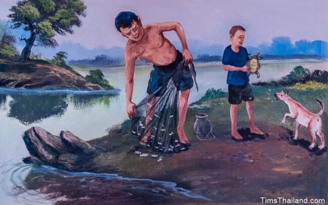 man and boy fishing with a net