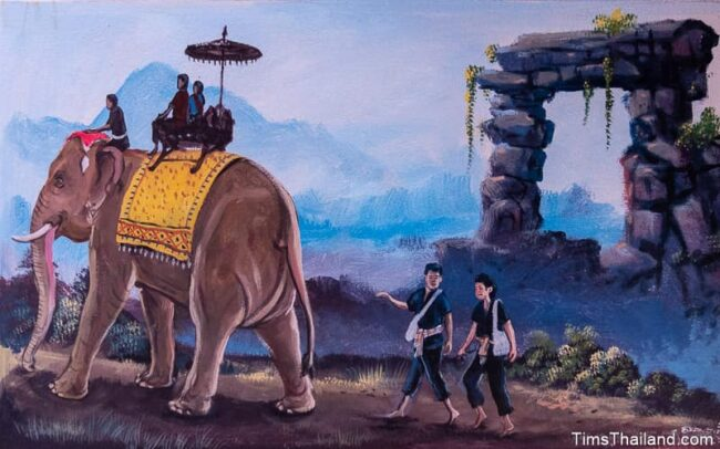 people riding an elephant and others walking behind it