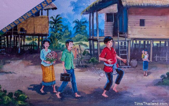 people walking through a village