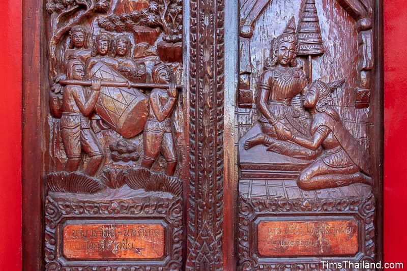 wood-carved shutters of men carrying a large drum and two women talking